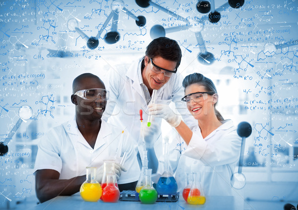 Smiling chemists looking at test tube Stock photo © wavebreak_media