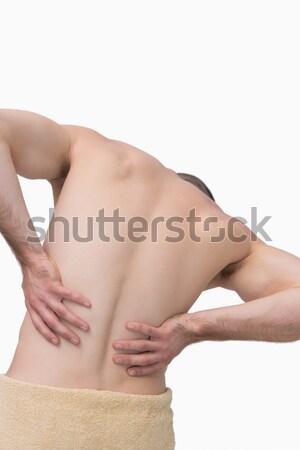 Vista posteriore a torso nudo uomo mal di schiena bianco mani Foto d'archivio © wavebreak_media