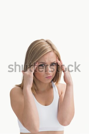 Young woman rubbing her temples Stock photo © wavebreak_media