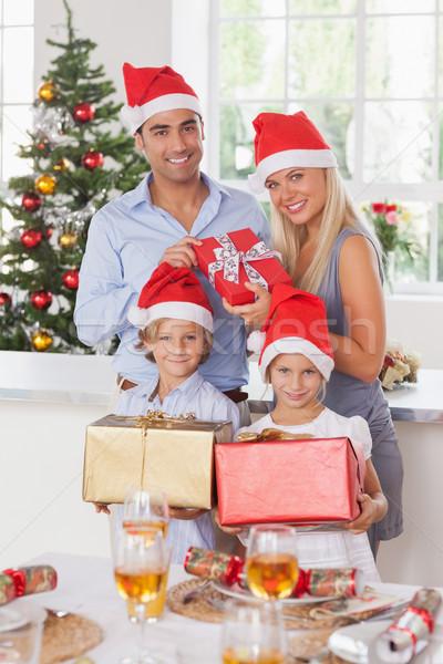 Family holding christmas presents Stock photo © wavebreak_media