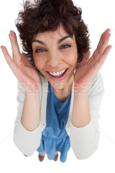 Overhead of amazed woman with hands wide opened Stock photo © wavebreak_media