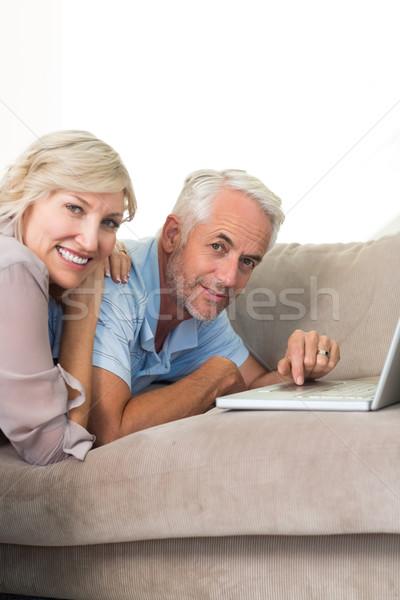 Stock fotó: Boldog · érett · pár · laptopot · használ · kanapé · portré