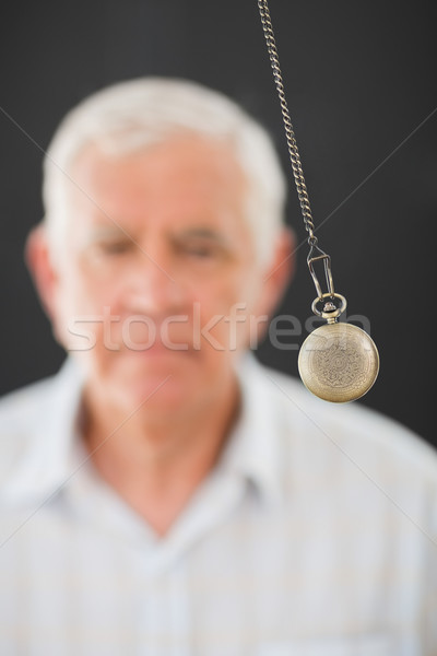 Senior man being hypnotized with pendulum Stock photo © wavebreak_media