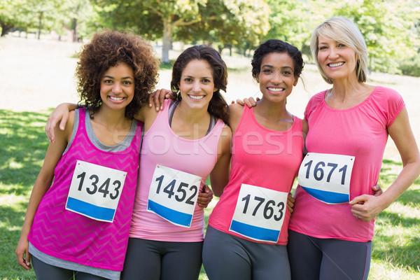 Női résztvevők mellrák maraton portré boldog Stock fotó © wavebreak_media