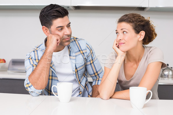 Fed up couple having coffee looking at each other Stock photo © wavebreak_media