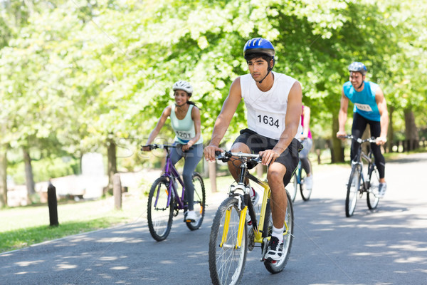 Cyclists riding bicycles on street Stock photo © wavebreak_media