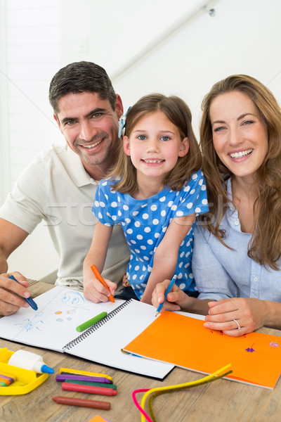 Happy daughter and parents coloring Stock photo © wavebreak_media