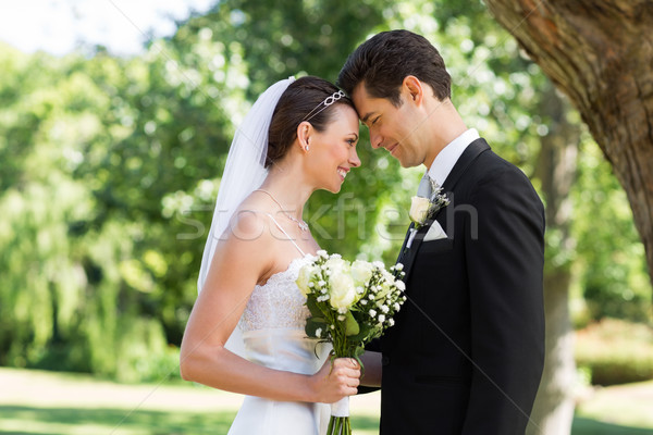 Loving newly wed couple in garden Stock photo © wavebreak_media