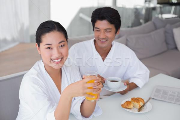 Couple in bathrobes spending the morning together Stock photo © wavebreak_media