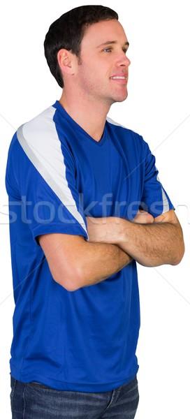 Smiling football fan in blue Stock photo © wavebreak_media