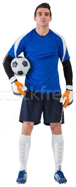 Handsome goalkeeper in blue jersey Stock photo © wavebreak_media