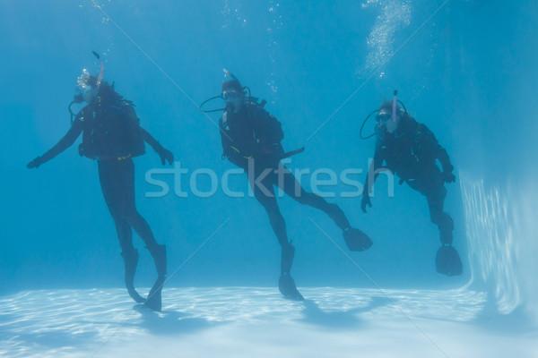 Three friends on scuba training submerged in swimming pool Stock photo © wavebreak_media