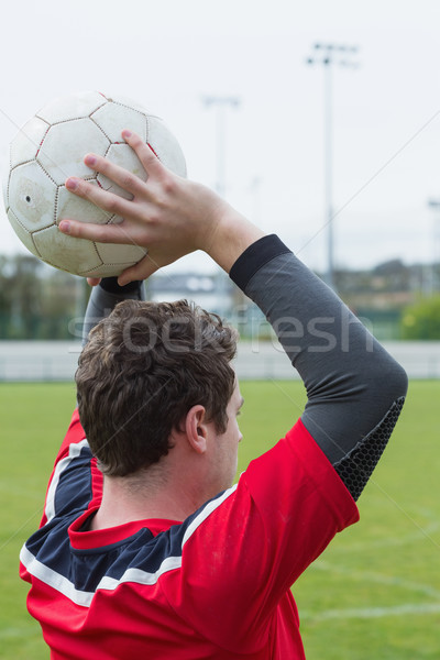 Football player in red throwing from sideline Stock photo © wavebreak_media