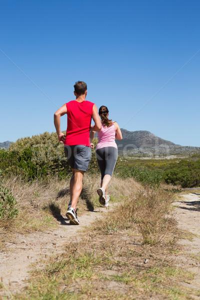 Active couple jogging on country terrain Stock photo © wavebreak_media