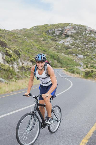 Moço mountain bike retrato estrada feliz Foto stock © wavebreak_media