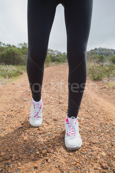 Low section of woman walking on country road Stock photo © wavebreak_media