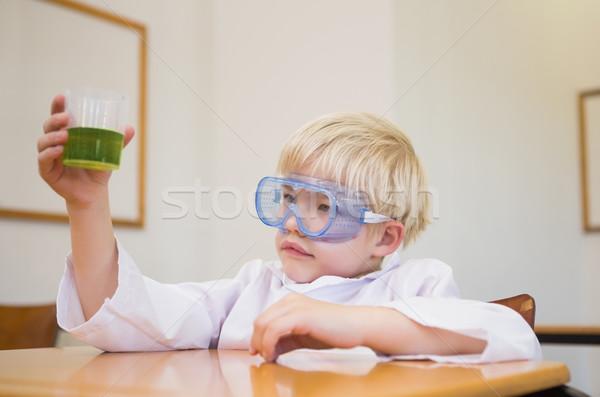 Cute pupil dressed up as scientist in classroom Stock photo © wavebreak_media