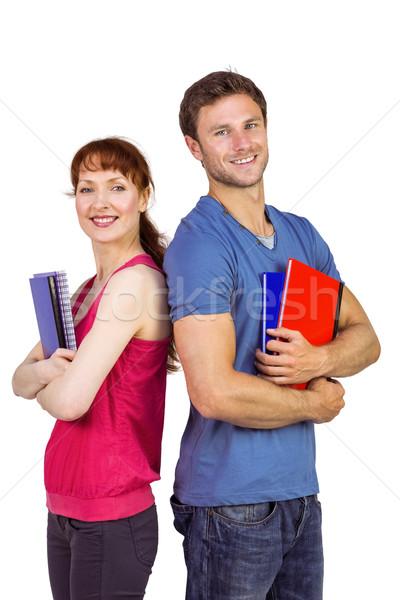 Foto stock: Dos · estudiantes · ambos · mirando · cámara · hombre