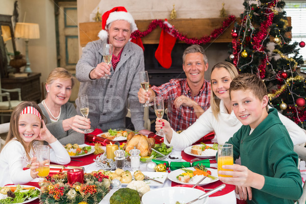 Extended family toasting at christmas dinner Stock photo © wavebreak_media