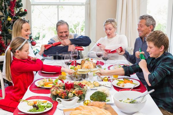 Család húz karácsony ebédlőasztal otthon nappali Stock fotó © wavebreak_media