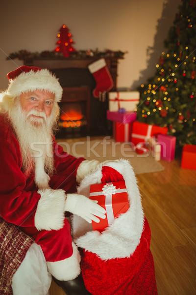 улыбаясь отец Рождества чулок представляет домой Сток-фото © wavebreak_media