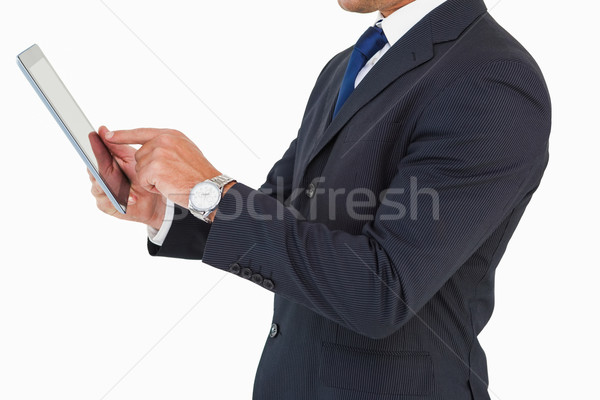 Businessman with watch using tablet pc Stock photo © wavebreak_media