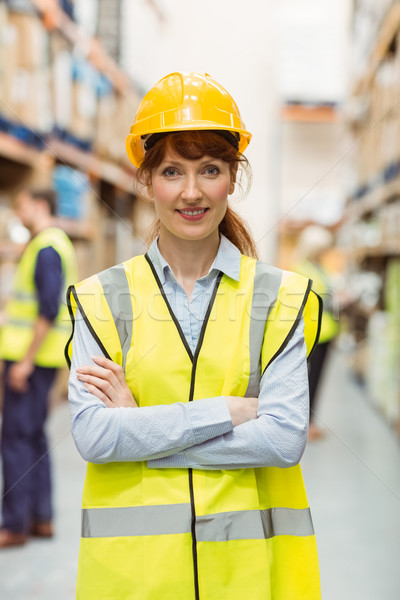 Warehouse manager smiling at camera with arms crossed Stock photo © wavebreak_media