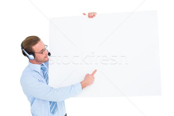 Businessman presenting card wearing headset Stock photo © wavebreak_media