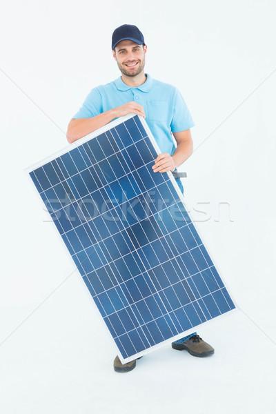 Glimlachend bouwvakker zonnepaneel portret witte Stockfoto © wavebreak_media