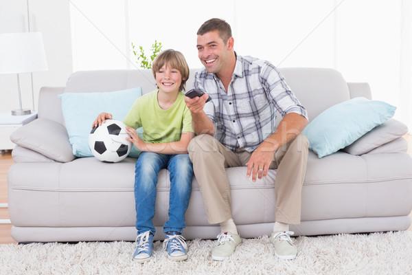 Vader zoon kijken voetbal wedstrijd sofa gelukkig Stockfoto © wavebreak_media