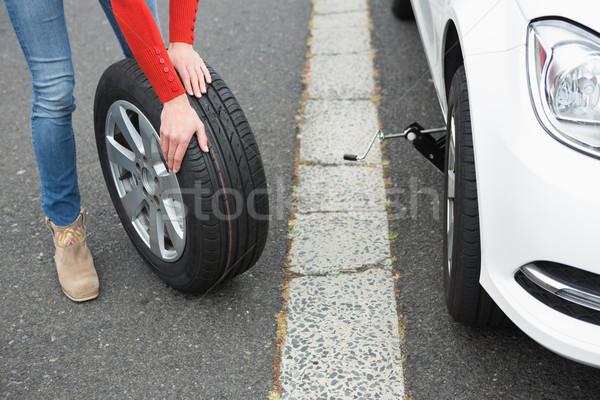 Mulher pneu carro roda estilo de vida reparar Foto stock © wavebreak_media