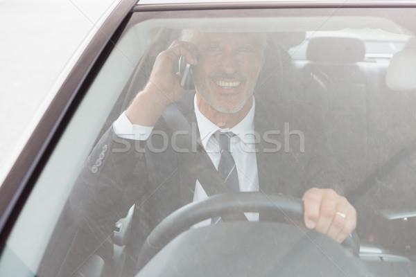 Sorridente homem sessão roda carro feliz Foto stock © wavebreak_media