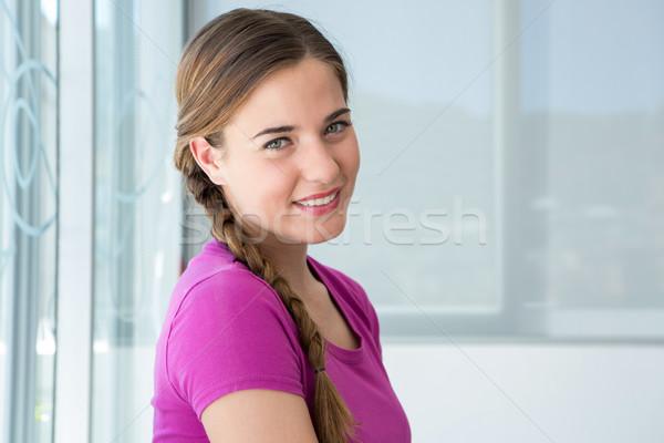 Casual young woman smiling Stock photo © wavebreak_media