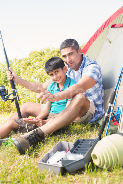 Father and son beside tent Stock photo © wavebreak_media