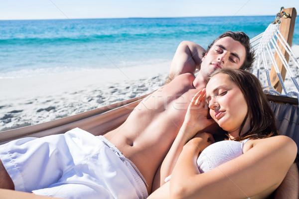 Boldog pár együtt függőágy tengerpart férfi Stock fotó © wavebreak_media