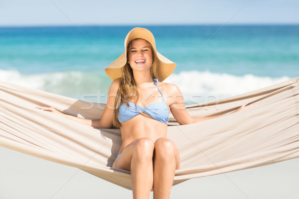 Pretty woman relaxing in the hammock and smiling at camera Stock photo © wavebreak_media