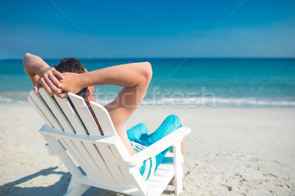 Man ontspannen dek stoel strand Stockfoto © wavebreak_media