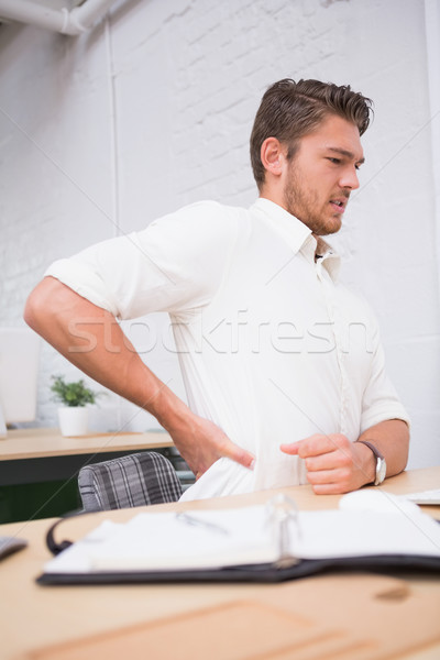 Businessman suffering from backache at office desk Stock photo © wavebreak_media