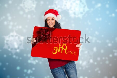 Composite image of woman holding a white sign Stock photo © wavebreak_media