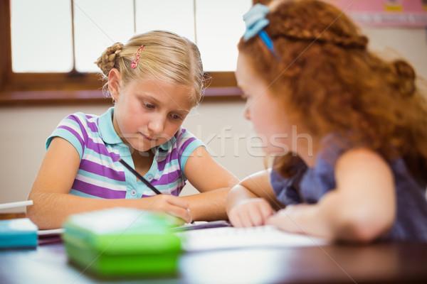 Pupils working hard at desk  Stock photo © wavebreak_media