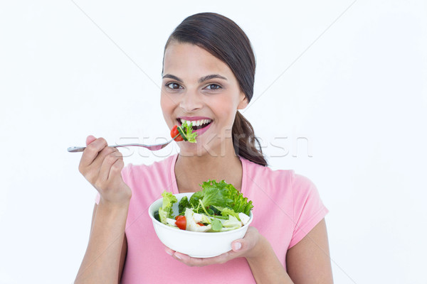 Mooie brunette eten kom salade witte Stockfoto © wavebreak_media