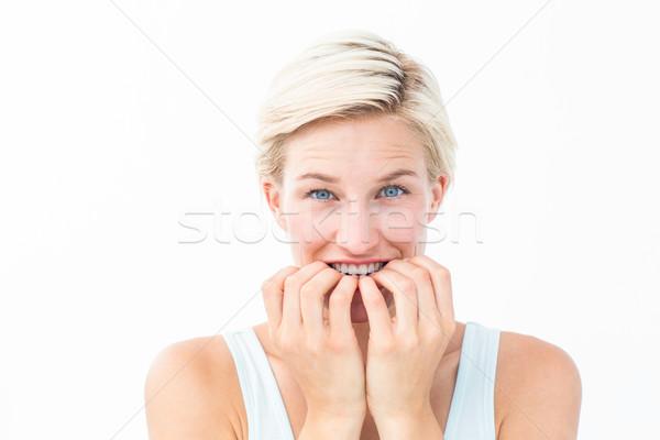 нервный женщину ногти глядя камеры Сток-фото © wavebreak_media