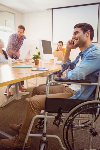 Yaratıcı işadamı tekerlekli sandalye telefon ofis bilgisayar Stok fotoğraf © wavebreak_media