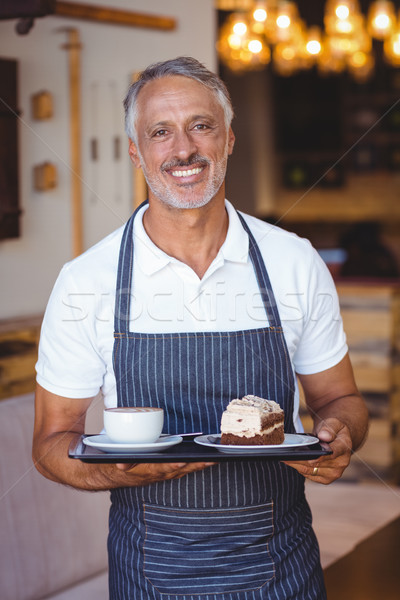 Camarero sonriendo bandeja Cafetería sonrisa Foto stock © wavebreak_media