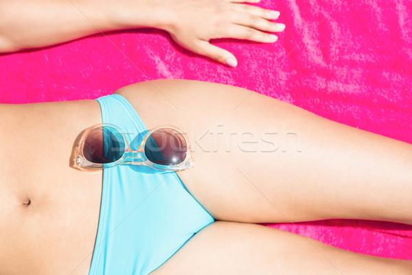 Mince femme serviette plage bikini Photo stock © wavebreak_media