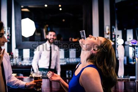 Smiling waiter serving a client Stock photo © wavebreak_media