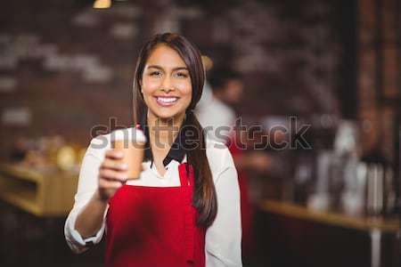 Sorridente garçonete caneca retrato café negócio Foto stock © wavebreak_media