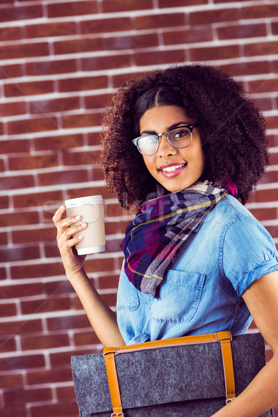 Smiling attractive hipster with felt bag and coffee Stock photo © wavebreak_media