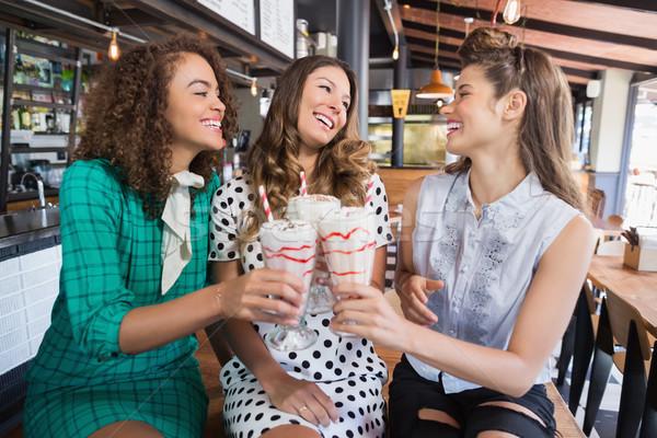 Female friends cheering drink in restaurant Stock photo © wavebreak_media
