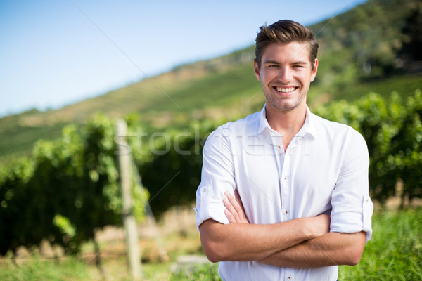 Portrait of smiling man with arms crossed standing at vineyard Stock photo © wavebreak_media